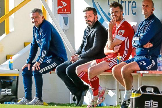 Derek McInnes looking shellshocked on the Dons bench.