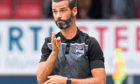 Ross County's manager Stuart Kettlewell instructs from the sidelines.