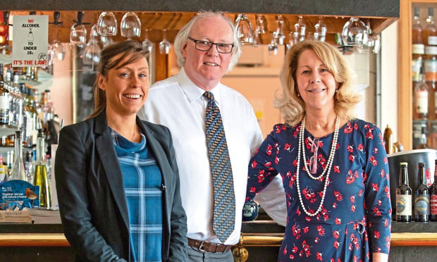 L-R: Jennifer Lamont, Murray Lamont and Ellie Lamont, owners of Mackays Hotel, in Wick.