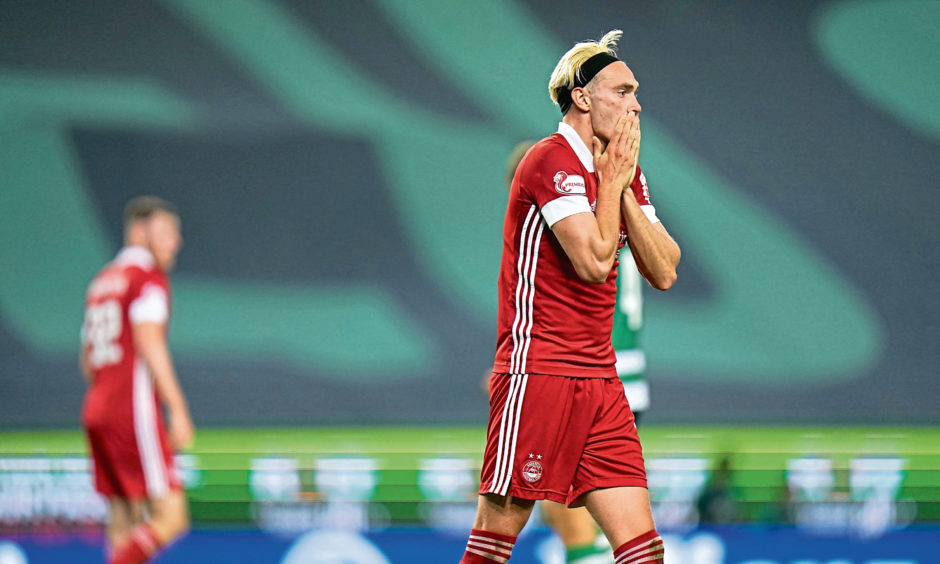 Aberdeen's Ryan Hedges is left frustrated after missing a chance during the UEFA Europa League 3rd Round qualifier against Sporting Lisbon.