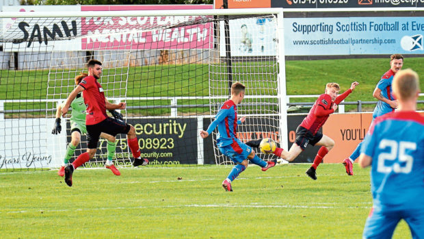 Roddy MacGregor strikes for Inverness and scores his second goal of the friendly against Elgin.