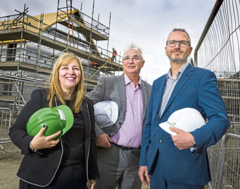 Springfield Properties chairman Sandy Adam, centre with chief executive Innes Smith and finance director Michelle Motion.