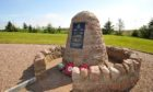 THE CAIRN AT THE FORMER RAF STATION AT LONGSIDE.(RAE/BROWN)