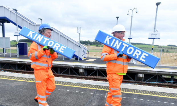 Councillor Martin Ford, left, and Robert McGregor, strategic transport officer at Aberdeenshire Council prior to the signs being installed earlier this year. Picture by Chris Sumner