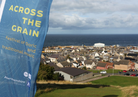 Councillor Anne Stirling, Saskia Gibbon from Aberdeenshire Council, and fiddler Tom Spiers launch Across the Grain at Macduff.