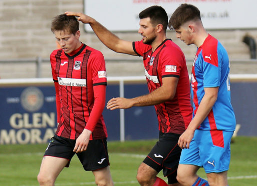 Kane Hester, left, after one of his goals against Inverness Caley Thistle.