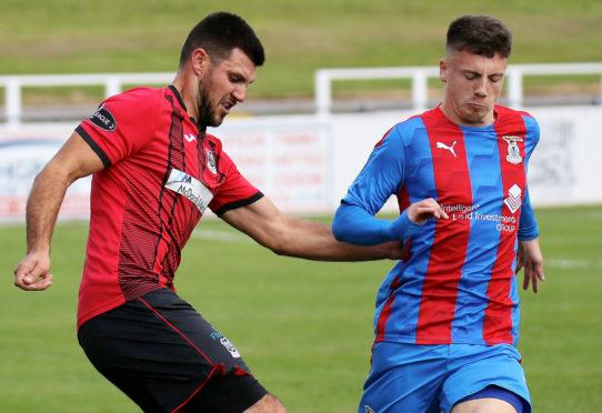 Daniel MacKay, right, challenges Elgin City defender Matthew Cooper.