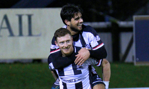 Shane Sutherland is congratulated by Rabin Omar.