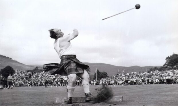 Local games heavyweight Bill Anderson puts the maximum effort into his hammer throw at the Braemar Gathering in 1969 (Photo: AJL)