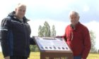 Chris van der Linden and Bob van Wyk at the memorial for the crew of ED761 near Waverveen, The Netherlands.