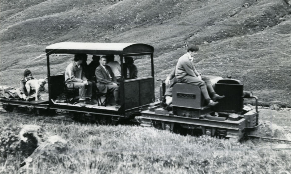 The Dalmunzie railway complete with passengers and a dog in April 1977.