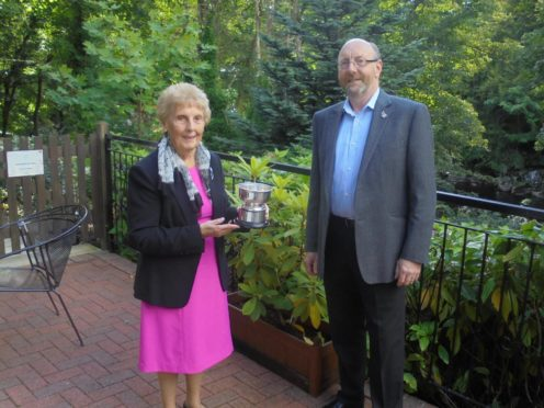 The Walter Smith Rosebowl was presented to Mrs Margaret Smith by the immediate past president of the club, Bob Watt.  Picture: Banchory Rotary Club