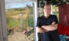 David Young moved into his garden greenhouse to protect his wife and mother.
