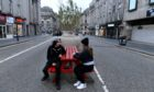 Members of the public try out the benches in Union Street. Picture by Chris Sumner.