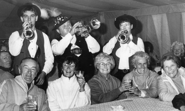 Members of The Eidelweiss Oompah Band and some of their guests give an idea of the atmosphere in the festival marquee at Aberdeen's Duthie Park at the start of Aberdeen Regensburg Week in 1987