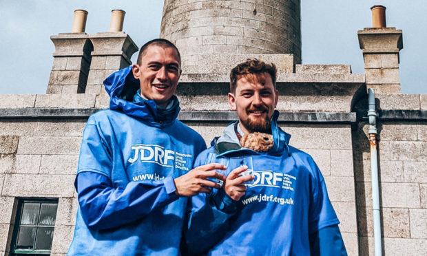 Kenneth Wilson and Darren McWilliam complete their 235-mile trek to Ardnamuchan.