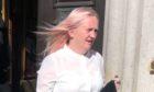 Gail Hansbury leaving Aberdeen Sheriff Court as David Buchan was remanded in custody.