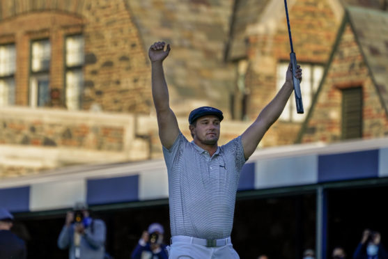 Bryson DeChambeau, of the United States, reacts after sinking a putt for par on the 18th hole to win the US Open Golf Championship.