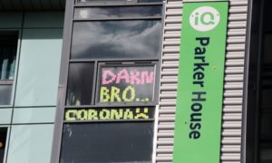 Abertay students have put lockdown signs in their windows at Parker House.