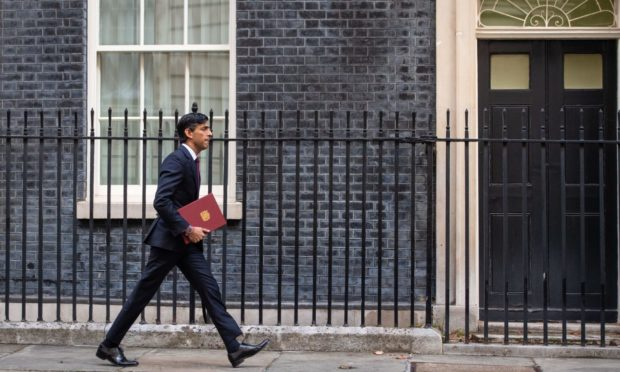 Chancellor of the Exchequer Rishi Sunak leaves No 11 Downing Street for the House of Commons to give MPs details of his winter economy plan.