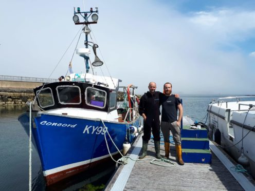 James Cameron and Alberto Morales Utrera with their boat Concord at Kyleakin, Syke.