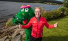 Bryan Burnett with Loch Ness Marathon Nessie ahead of the launch of the virtual Runners cafe this weekend.