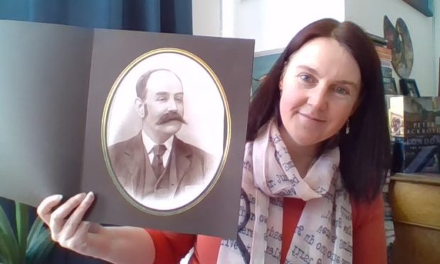 Lorna Steele with a picture of her great great grandfather William Edwards