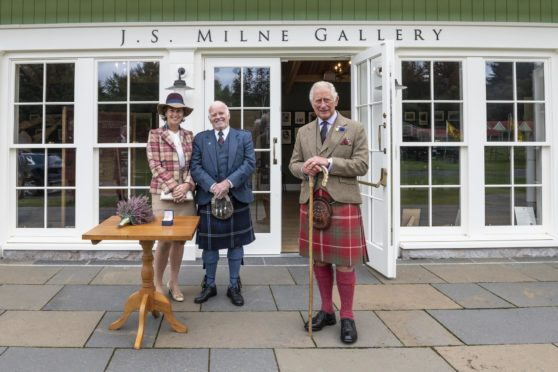 Mr Milne with his wife Gillian and HRH The Duke of Rothesay outside the Highland Games Pavillion at the Princess Royal and Duke of Fife Memorial park in Braemar.