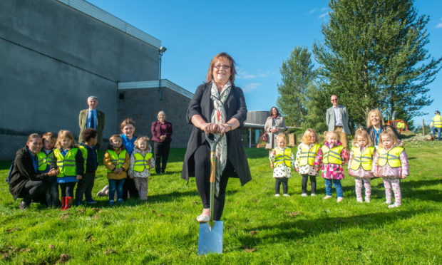 Sonya Warren, chairwoman of Moray Council's children and young people's committee, begins construction on the new nursery.