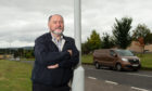 Elgin City South councillor John Divers next to the A941 Rothes road in Elgin.