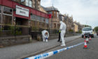 Forensic officers at the scene in Buckie