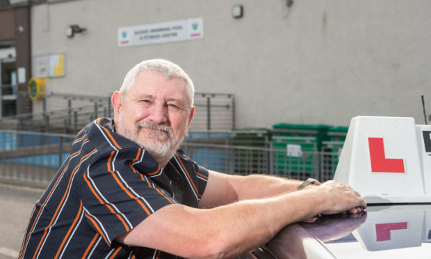 Driving instructor Bill Addison outside Buckie swimming pool.