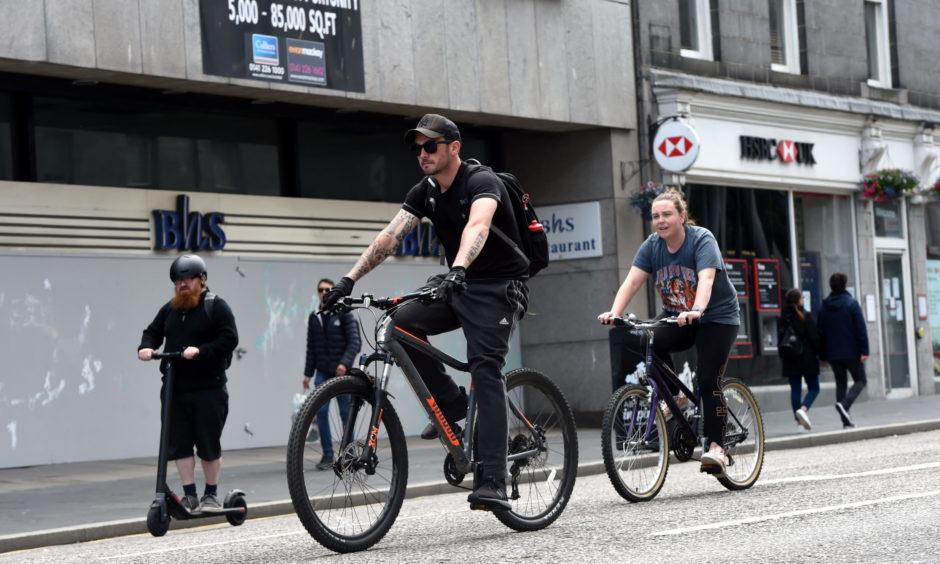 Cyclists on Union Street, Aberdeen.