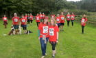 Suzanne McDonald and Louise Milner (front) with the group of walkers taking part.