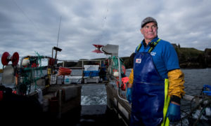 Wes Lewis on his boat off the coast of Stonehaven, fishing for Lobster and Crab