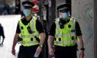 Police in Belmont Street, Aberdeen. Picture by Scott Baxter.