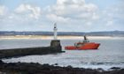 A boat leaves Aberdeen Harbour at Greyhope Bay. Picture by Scott Baxter