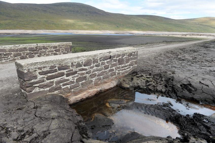 A stone bridge no longer submerged in the loch.