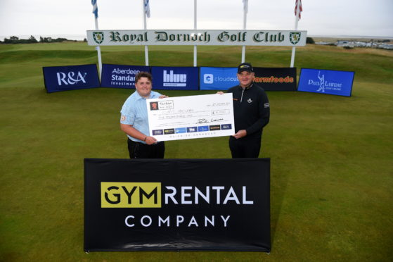 Picture by SANDY McCOOK     Royal Dornoch Masters competition as part of the Tartan Pro Tour winner Chris MacLean receives his winners trophy and cheque from Paul Lawrie afer a playoff in Dornoch last night.