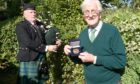 Picture by SANDY McCOOK  17th September '20 CR0023848   John Kay, of Ashton Road, Inverness and formerly of the Royal Scots with his medal from the Royal British Legion with which he was presented yesterday. Also in the photograph is piper Tam Cornwall, also formerly of the regiment.