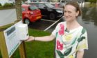 Caroline Gregory of Fort Augustus with the village car park hand sanitiser. Picture by Sandy McCook.