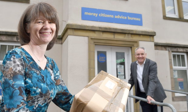Sonya Hayward, fair delivery campaign coordinator for Moray Citizens Advice Bureau with Moray MSP Richard Lochhead as they launch their new campaign against unfair postal charges.