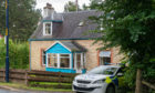 Police outside the house on Kingussie Road in Newtonmore
