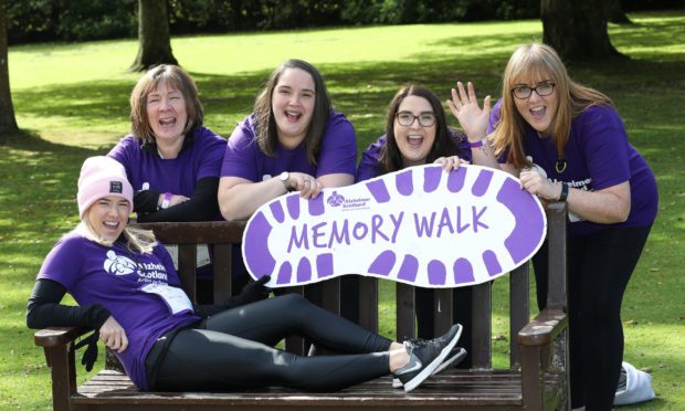 Walkers celebrate taking part in the Alzheimer Scotland Memory Walk in Hazlehead Park, Aberdeen.  Picture Simon Price/Firstpix