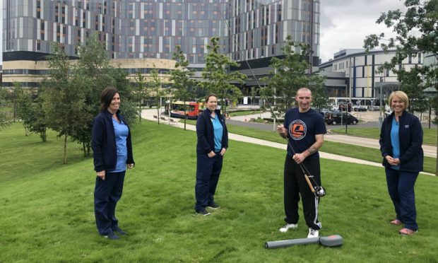 Robbie Bell with nurse Tracey McKissack; physiotherapist Susan Gilhespie and occupational Therapist Amanda Howat outside Glasgow's Queen Elizabeth University Hospital.