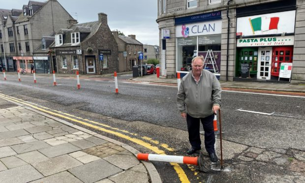 Councillor Bill Cormie claims the fallen bollards in Rosemount Place are a tripping hazard.