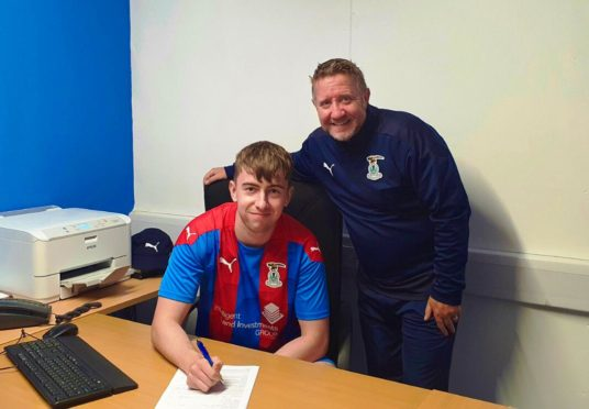 Ryan Fyffe with Caley Thistle manager John Robertson.