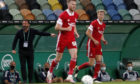 Derek McInnes, left, gestures during the Europa League third qualifying round game between Sporting CP and Aberdeen.