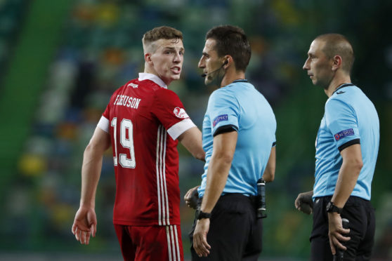 Aberdeen's Lewis Ferguson talks to the referee during the Sporting CP game