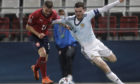 Czech Republic's Jaroslav Zeleny, left, takes down Scotland's Andy Robertson to give away a penalty.